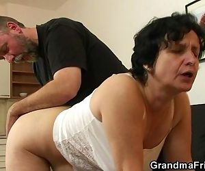 Granny in white lingerie swallowing two cocks after pussy..