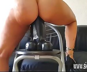 Insatiable amateur slut rides a gigantic dildo 6 min