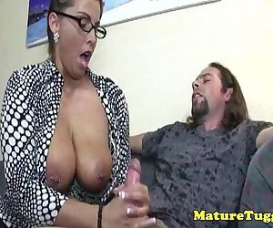 Busty spex milf gets cumshot after handjob - 5 min