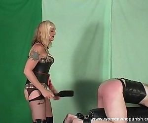 Mistress Kelly spanks and paddles her slave on the..