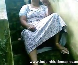 Indian Busty Housewife Exposing Her Pussy Sitting Outside..