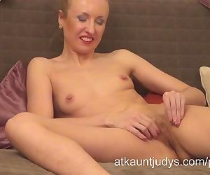Amateur mature MILF Yulja strips and spreads.