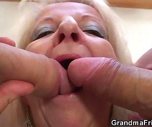 Blonde grandma takes two big cocks at once