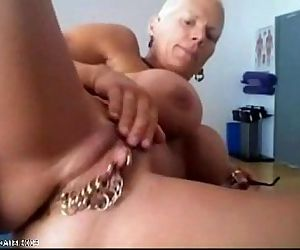 Bysty MILF Heather with 15 piercing rings in her pussy..