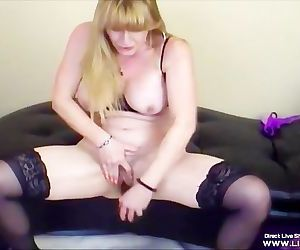 Squirting busty cougar Kay fucks her old holes