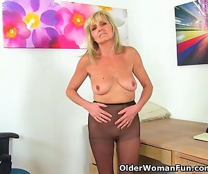 English gilf Dolly puts her dildo to work on her craving..