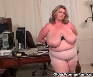 BBW milf Kimmie KaBoom shows off her secretary skills