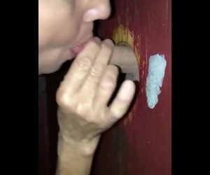 50 yr old slut milf sucking cock in glory hole, takes load