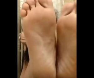 50 year old woman shows her feet for cum