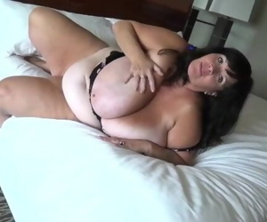 Suzie Q Mature BBW Plays with Her Huge Tits in a Hotel..