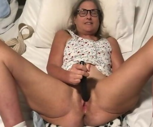 Milf in glasses spreads pussy and masturbates with black..