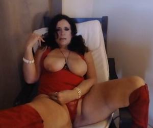 MATURE SMOKING with big natural titties out