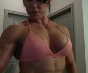 Muscle girl wears a small thong