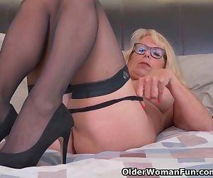 Blonde milf Bianca finger fucks her mature pussy