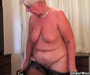 British and full figured granny Sandie masturbates with a..