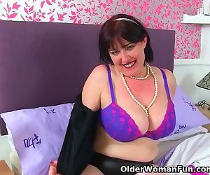 UK milf Janey is up to no good in fishnet stockings