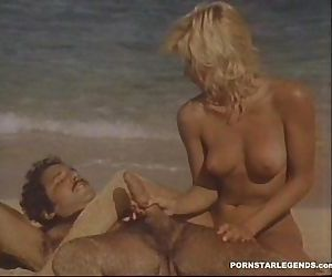 Ginger Lynn gets big cock fucking from Ron Jeremy