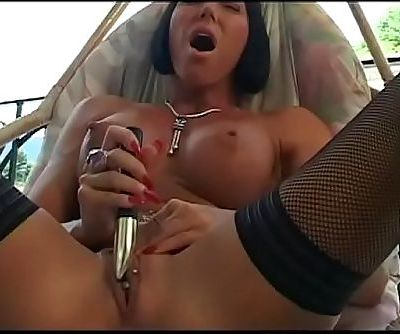Stunning brunette milf plays with a dildo