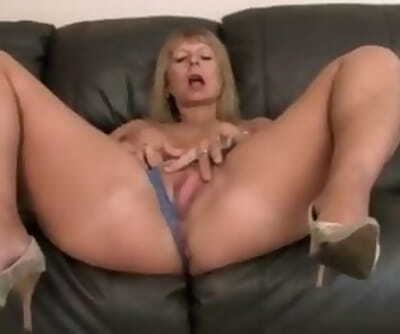 Busty Cougar Rubs Her Shaved Pussy