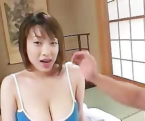 Playing with her naturally busty asian tits