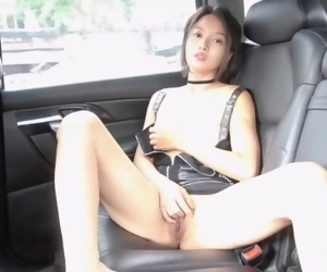 Cute Asian Girl fingers her shaved pussy until orgasm in her car