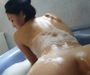 June Liu / SpicyGum : Cute Asian Student Practicing Chinese Massage in Bath