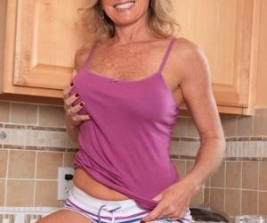 Aged lady Jade Jamison unveiling nice melons in kitchen..