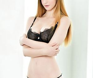 Solo girl Stella Cox slips off black bra and panty combo..