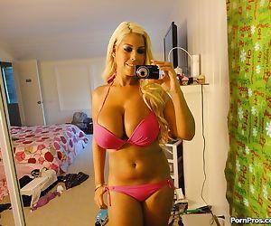 Blonde Latina bombshell Bridgette B peeling off pretties..