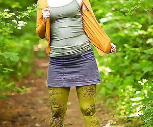 Geeky amateur chick Estella Z stripping naked in woods to..