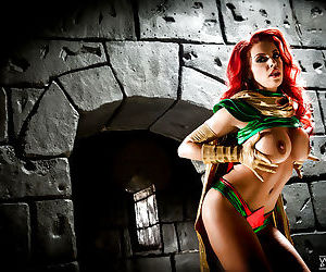Busty redhead Britney Amber modeling topless in cosplay..