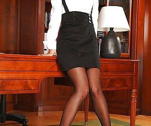 Hot secretary in glasses Angel Pink stripping off her..