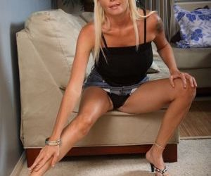 Hot older blonde Leah Love uncovers her big tits and pink..