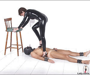 Saucy femdom in latex outfit torturing and stroking off..