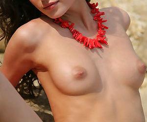 Euro beach babe Irina B tanning her naked hot body near..