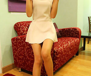 Skinny amateur Ping shows flat chest & removes panties for..