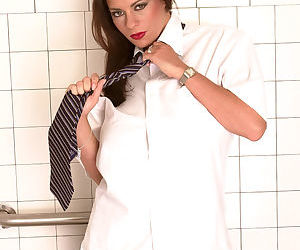 Housewife Linsey Dawn McKenzie takes off all her clothes..