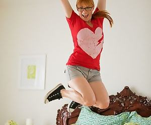 Cute ginger with glasses Penny Pax stripping down naked in..