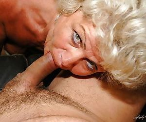 Slutty granny in stockings gives a blowjob and gets..
