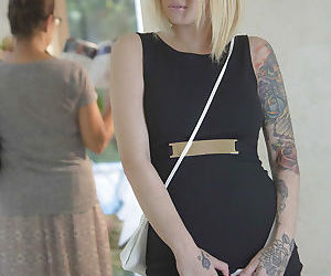 Glasses wearing tattooed blonde Emma Mae exposing large..