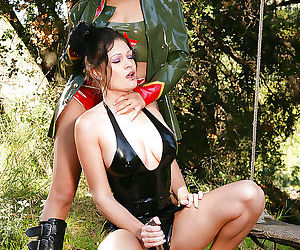 Two cuties in latex are fucking in the forest and playing..