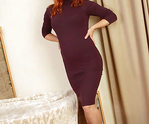 Mature girlie in high-heels Velma is a redhead tart with..
