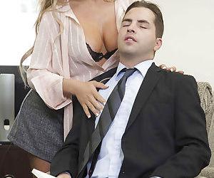 Glasses clad blonde Corrina Blake revealing big tits for..