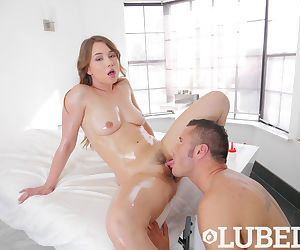 Nude girl Taylor Sands douses herself in oil as she gets..