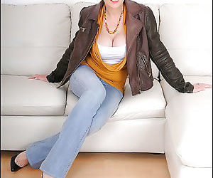 Mature lady in blue jeans uncovering her big jugs and..