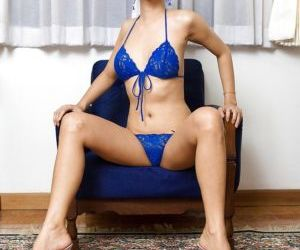 Horny Thai tranny Pop spreading her hot pussy in a blue..