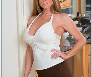 Curvaceous mature lady Darla Crane gets rid of her suit..