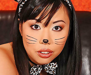 Tattooed asian tigerr benson rubs her big tits and toying..