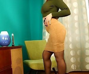 Skirt and nylon attired Yasmin Scott baring big breasts..