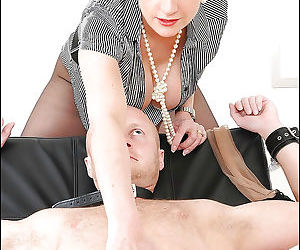 Busty mature femdom stroking and torturing her male pets..